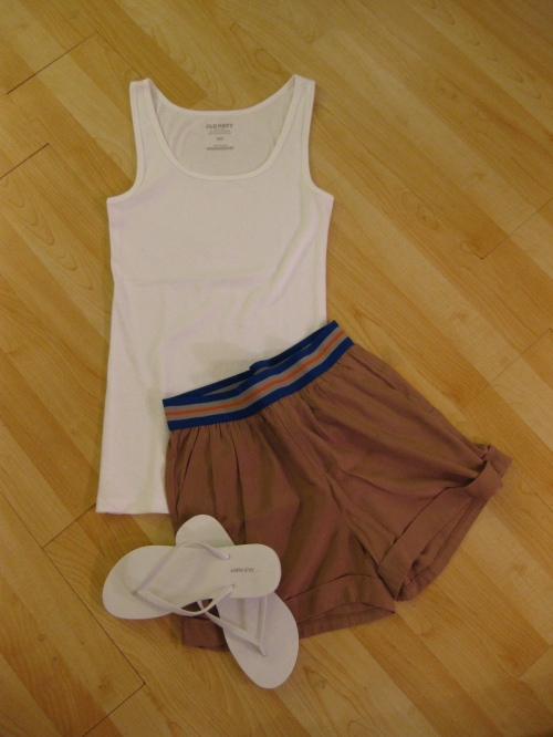 A Basic White Tank Top with Tan Trouser Shorts