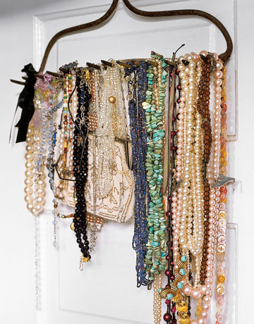 Creative Jewelry Solution - Necklaces Hanging from an Upside-Down Rake