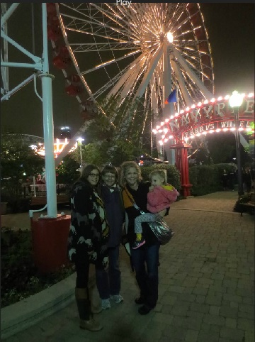 Family in Front of Ferris Wheel
